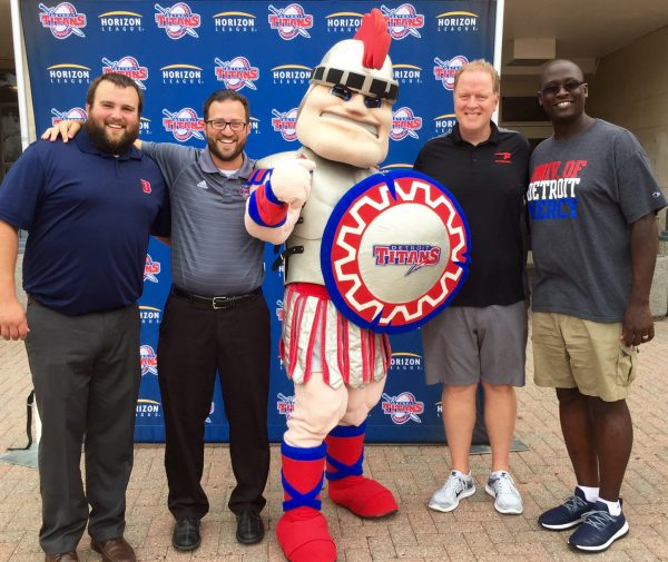 Fantelope CEO Derek Mehraban with Detroit Titans mascot Tommy Titan, Men's Basketball Coach Bacari Alexander, and Jeremiah Hergott and Mitchell Sweet from Athletic Marketing & Promotions.